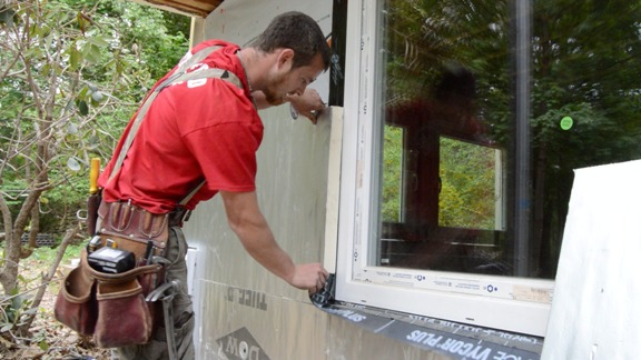 Make sure the rigid foam overlaps the window frame