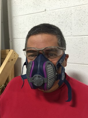 Worker wearing half-face respirator