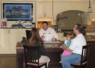 Alure Home Improvement salesman with customers in the showroom