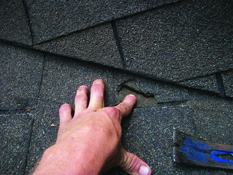 roofing with shingles during roofing inspection