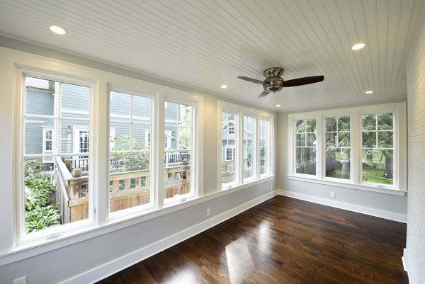 the sun room features woodhaven ceiling planks from armstrong ceilings are accented by recessed lighting and a minkaaire ceiling fan from