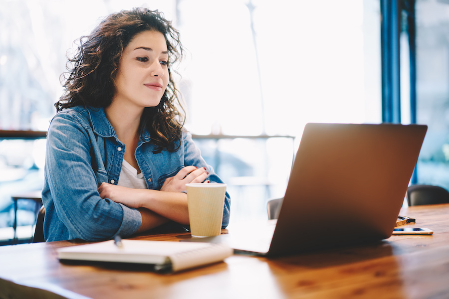 Woman looking at a webinar on her laptop