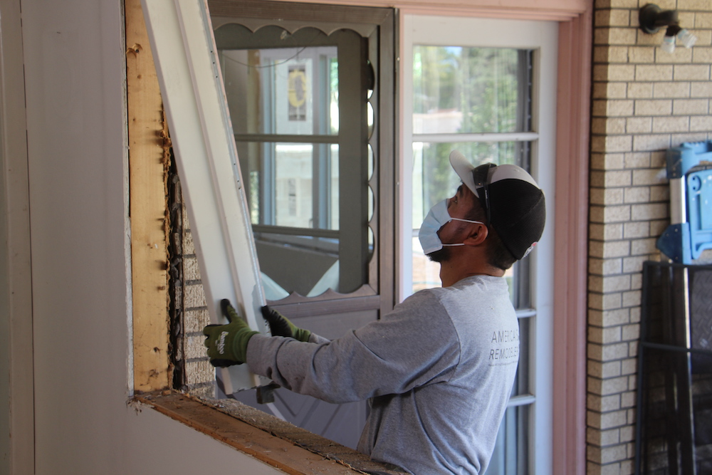 remodeler installing a window during covid-19