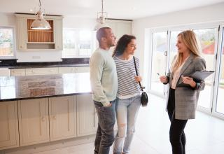 realtor suggesting remodeling services to new buyers and sellers