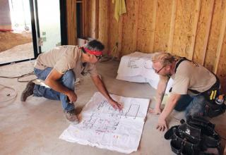 remodelers working on plans