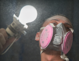 Worker with dust in the air on a jobsite. Photo: courtesy ITW