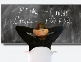 Lessons learned-man ponders equation on blackboard-Pixabay image