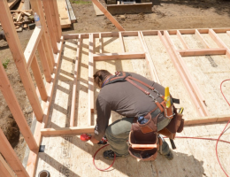 Carpenter Ben Bogie framing the walls of the model remodel project