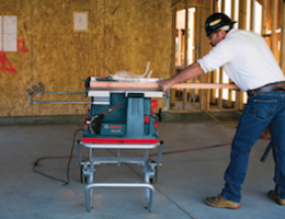 The Reaxx portable table saw in use.