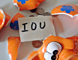 Unpaid invoices and IOU in piggy bank