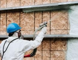 contractor applies insulation to home
