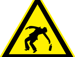 Caution sign with drunk person