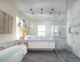 primary bathroom with large mirror in remodel