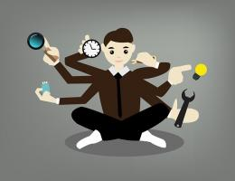 Seated man with with 6 arms each juggling a different task