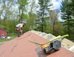 Carpenter ben bogie sheathing the Model ReModel project's roof
