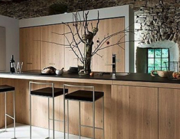 Modern rustic kitchen with stainless steel, wood, and stone.