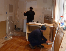 subcontractors—plumber and electrician—at work