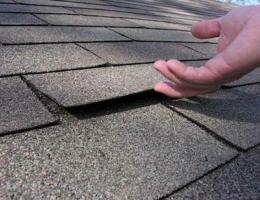 Loose shingles indicate use of short roofing nails, inspector says