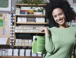 Woman holding green paint can