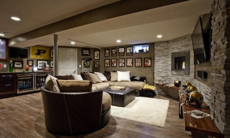 New finishes transformed one end of the basement into a bright, inviting media c