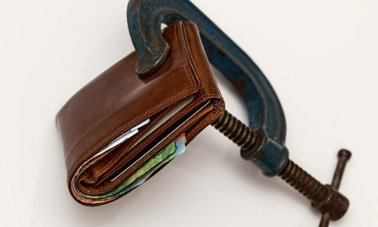 Wallet squeezed in a C-clamp