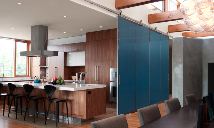 Barn doors can be used to divide large, open spaces. Photo: courtesy Baldur by Krown Lab