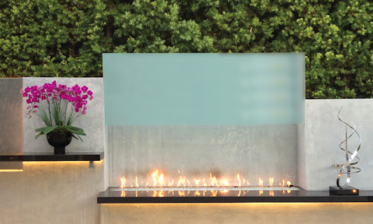 Fireplaces have long been a staple of outdoor room design, but more manufacturers are now making gas fireplaces for exterior use, dramatically altering the look of the space from rustic or transitional to a modern aesthetic.