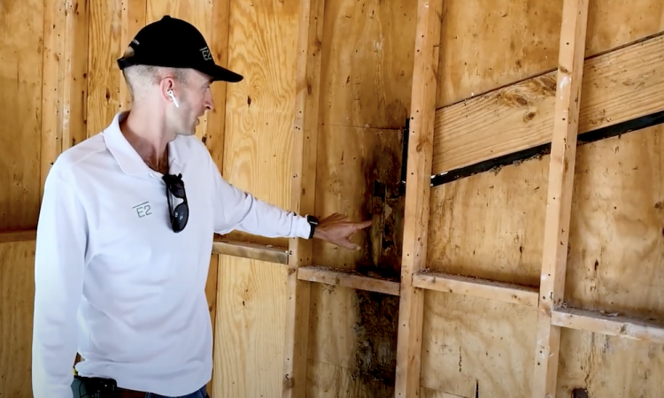 rob smith shows water damage from bad roofing flashing