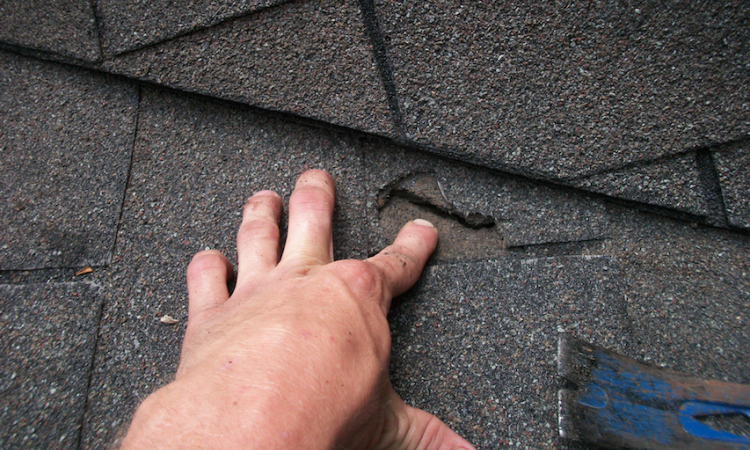 Close-up photo of asphalt shingle roof repair