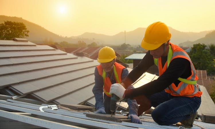 Workers on a roof installation