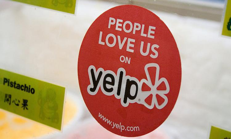 Yelp sticker on business door.
