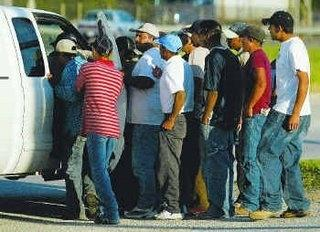 Latino workers crowd around potential hirer