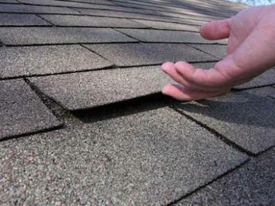 Loose Shingles Indicate Use Of Short Roofing Nails