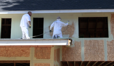 StoGuard fully adhered air and moisture barrier being applied to a wall